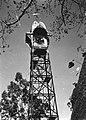 A Clock Stands in a War-Damaged Town (BOND 0571).jpg