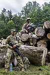 A Soldier from the 10th Combat Aviation Brigade, pulls security with soldiers from the Latvian National Guard.jpg