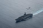 A U.S. Air Force E-3 Sentry flies over USS Theodore Roosevelt. (36566322642).jpg