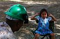 A girl talks with U.S. Marine Corps Staff Sgt. Antonio Tyler, a project manager with 9th Engineer Support Battalion, 3rd Marine Logistics Group, at the Erdmiin Oyun School in the Nalaikh district of Ulaanbaatar 130726-M-MG222-004.jpg