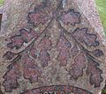 A gravestone with oak leaves, St Maur's Glencairn Churchyard, Ayrshire, Scotland.jpg