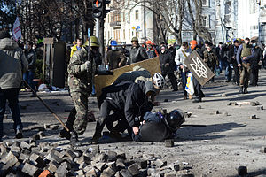 Internal Troops of Ukraine - Police officer attacked by protesters during clashes in Kiev, February 18, 2014