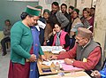 A polling official administering indelible ink to a voter at a polling booth, during the Himachal Pradesh Assembly Election, in Kothi village, dist. Kinnaur, Himachal Pradesh on November 09, 2017.jpg
