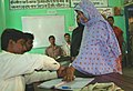 A woman voter registering her name at Sammatinagar Gram Panchayat polling booth of Jangipur constituency in Murshidabad, West Bengal on May 07, 2009.jpg