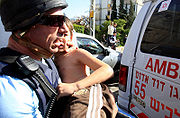 A wounded Israeli Child is taken to hospital after Rocket Attack