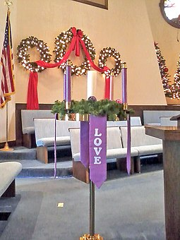 On Christmas, the Christ Candle in the center of the Advent wreath is traditionally lit in many church services. Advent Wreath (Broadway United Methodist Church).jpg