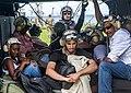 Aircrewman prepares victims inside an MH-60S Sea Hawk for evacuation. (37279187042).jpg