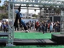 9bb8182fdb3d An American Ninja Challenge competitor in a Batman costume.