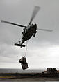 An MH-60 Seahawk helicopter delivers supplies on the flight deck of the amphibious assault ship USS Boxer (LHD 4) during an under way replenishment in the Pacific Ocean March 17, 2011 110317-N-ZS026-024.jpg