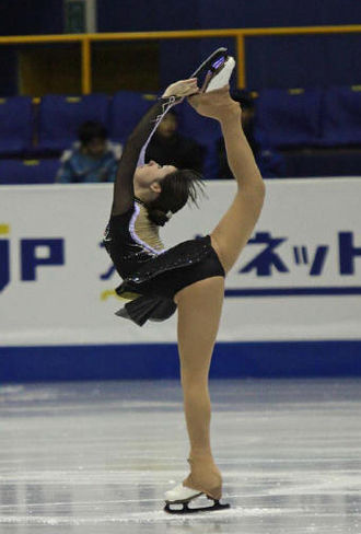 Angela Maxwell - Maxwell performs a Biellmann spin during her What Hands Can Do/Waltz Masquerade short program at the 2008-2009 Junior Grand Prix Final.