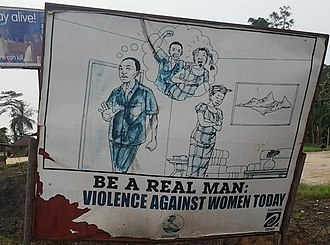 Violence against women - Anti-domestic violence sign in Liberia