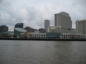 One Canal Place - One Canal Place (center right) seen behind the Aquarium of the Americas from across the Mississippi