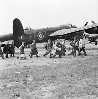 """Lübeck Airport - An Avro Lancaster during """"Operation Exodus"""" with British ex-POWs at Lübeck Airport in 1945"""