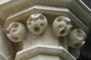 Ball flower - Newly carved ball flower ornamentation at Gloucester Cathedral.