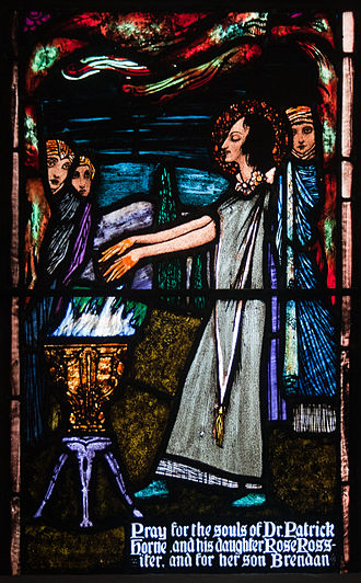 Rose of Lima - Stained glass window by Harry Clarke, located in St. Michael's Church, Ballinasloe, Ireland, depicting St. Rose burning her hands in an act of penance.