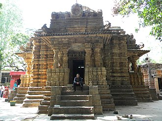 Bhoramdeo Temple - Main entrance to the Bhoramdeo Temple with the Ishtaliq or brick built ruined temple to its left and a small red painted shrine dedicated to Hanuman on the right