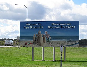 A provincial welcome sign in English and French, the two official languages of the province Bienvenue au Nouveau-Brunswick.jpg