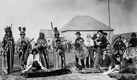 Cree men, including Big Bear (Mistahi-maskwa) trading with colonists at Fort Pitt, Saskatchewan, 1884 Big Bear at Fort Pitt, Saskatchewan, in 1884.jpg