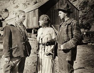 Big Timber (film) - Lumberman Jack Fyfe (Reid, left) is interested in Stella Benton (Williams). She is the cook for her brother Charlie Benton (Paget, right) at the lumber camp in this still.