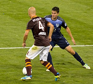 Matt Besler - U.S. teammates Michael Bradley and Besler vie for the ball in the 2013 MLS All-Star Game.