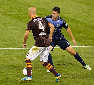 Matt Besler - U.S. teammates Michael Bradley and Besler vie for the ball in the 2013 MLS All-Star Game.