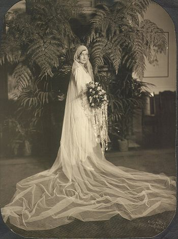 A bride in an elaborate wedding dress from 1929.