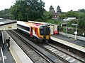 British Rail Class 444 passing through Liphook Railway Station in Liphook, Hampshire, England.jpg