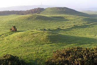 Round barrow - Round barrows on the chalk ridge of Bronkam Hill in Dorset, England. There are numerous round barrows along the south Dorset Ridgeway, including some well-preserved examples of the different sub-types.