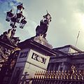 Buckingham Palace front gates with unicorn.jpg
