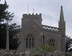 Stone building with arched windows and a square tower.
