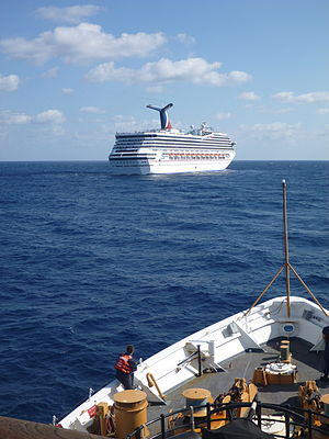 Carnival Triumph - The Coast Guard cutter USCGC ''Vigorous'' stands by to assist Carnival Triumph in the Gulf of Mexico on Feb. 11, 2013.