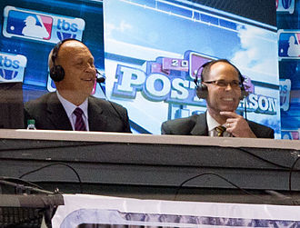 Ernie Johnson Jr. - Johnson (right) in the broadcast booth with Cal Ripken Jr. during the 2012 American League Division Series