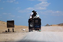 A packed jeep moving in the desert of Tharparkar