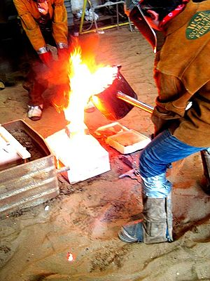 Casting (metalworking) - Casting iron in a sand mold