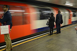Central line train leaving Mile End station(14795706427).jpg