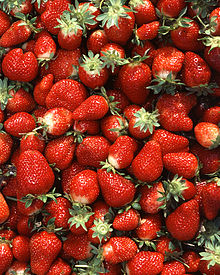 A closeup view of hundreds of red strawberries.