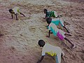 Children in full exercise with a guide in Godomey Benin.jpg