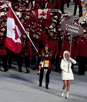 Clara Hughes - Led by Clara Hughes, the Canadian team enters BC Place during the opening ceremonies of the 2010 Winter Olympics.