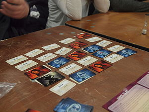 Codenames (board game) - Codenames at the end of play. The game has ended because the assassin (the black card on the left edge) has been found.