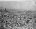 Cologne Cathedral stands undamaged while entire area surrounding it is completely devastated. Railroad station and... - NARA - 531287.tif