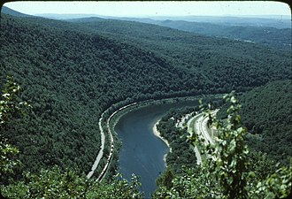 Lackawanna Cut-Off - Westbound Conrail freight snakes through the Delaware Water Gap, just north of Slateford Jct., in this summer 1977 photo taken from Mount Tammany.