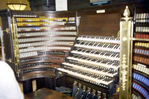 Organ console - The console of the Wanamaker Organ in the Macy's (formerly Wanamaker's) department store in Philadelphia, featuring six manuals and colour-coded stop tabs.