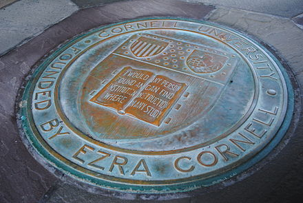 Cornell seal beneath the tower of Myron Taylor Hall Cornell seal at Law.JPG