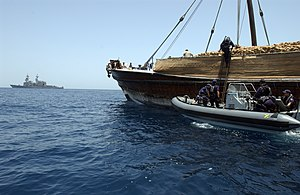 HMNZS Te Mana (F111) - A boarding party from Te Mana commencing inspection of a dhow in the Gulf of Oman during May 2004
