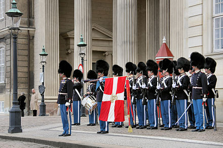 269eff64fc3 Soldiers of the Danish Royal Life Guards presenting arms
