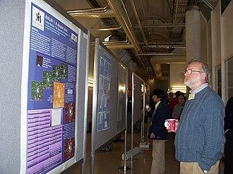 David Malin - David Malin looking at a poster about Malin 1, a galaxy found by him