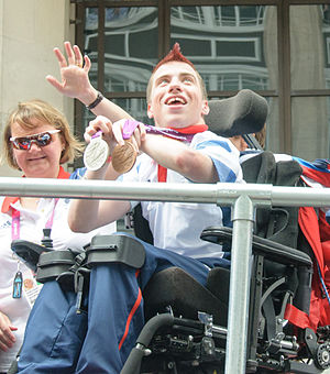 David Smith (boccia) - David Smith with his coach Sarah Nolan at heroes' parade in London.