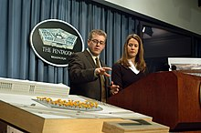 Keith Kaseman and Julie Beckman present the design at a Pentagon press conference March 3, 2003