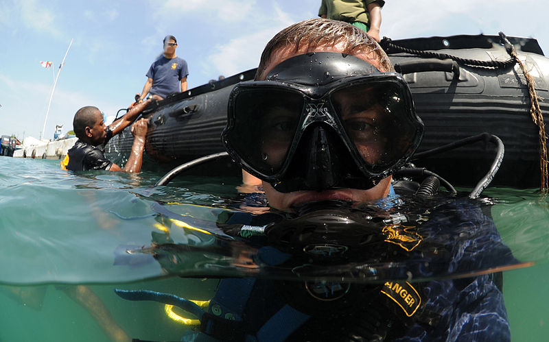 File:Defense.gov News Photo 110722-N-XD935-246 - U.S. Navy Petty Officer 2nd Class Justin McMillen assigned to Mobile Diving and Salvage Unit 2 surfaces after a dive with a member of the.jpg