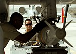 Defense.gov News Photo 110808-F-AU128-587 - U.S. Air Force Staff Sgt. Robert Corso steadies the MJ-1B Jammer delivering a GBU-38 bomb to an A-10C Thunderbolt II while Staff Sgt. Renaldo.jpg